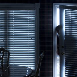 This photo illustrates a home break in at night through a back door from inside the residence.